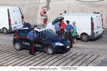 Italian Policemen Check Documents Of Men
