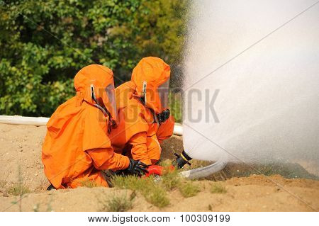 Orel, Russia - August 28, 2015: Two Russian Emergency Control Firemen In Orange Uniform Extinguishin