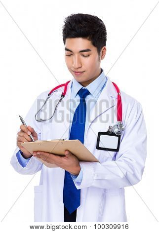 Young doctor take note on patient report