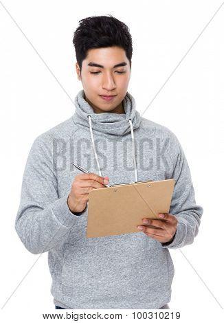 Man write on clipboard
