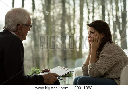 Psychotherapist Talking With Depressed Woman