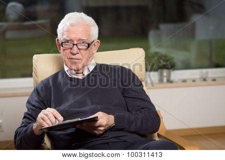 Senior Psychotherapist Holding Clipboard