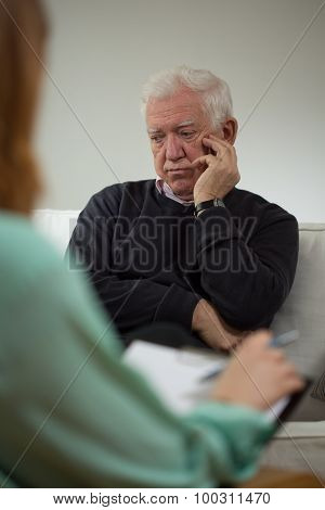 Sad Man Talking With Psychiatrist
