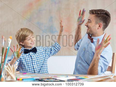 Art Class Teacher And Pupil