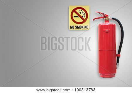 Fire Extinguisher Label On Concrete Wall With No Smoking Sign.