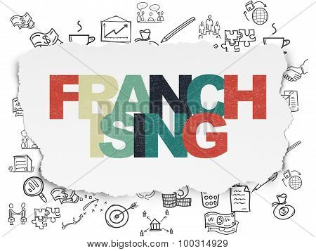 Business concept: Franchising on Torn Paper background