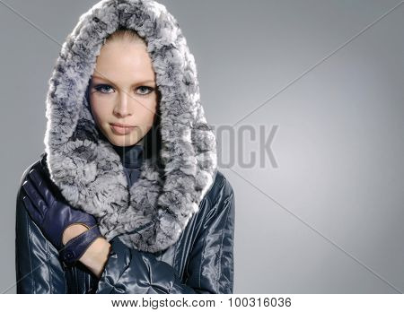 portrait of fashion model posing on light background