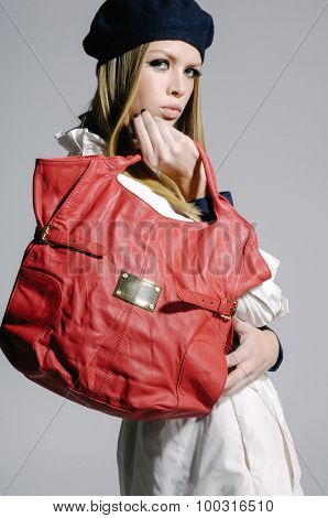 fashion model in coat clothes with hat,bag â??gray background