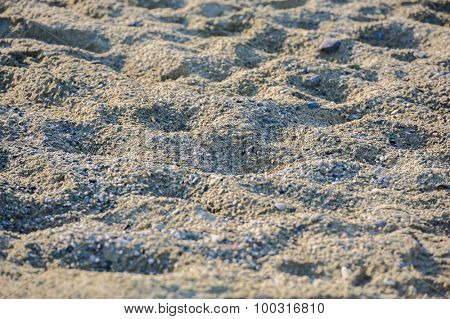 Beach sand at sunset, selective focus, suitable as background