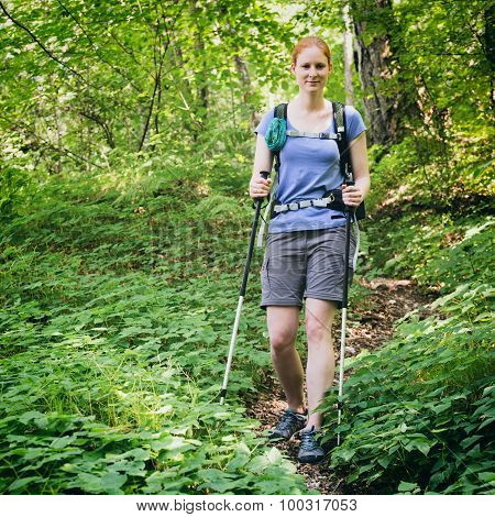 Woman Hiking In A Forest