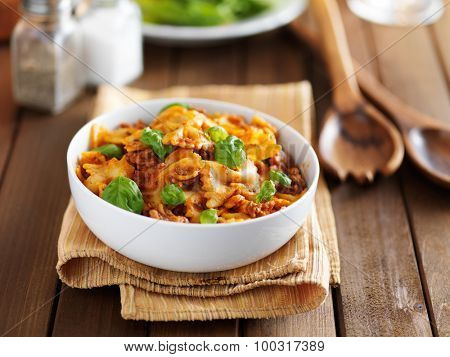 meaty bowtie pasta with ground beef  and tomato sauce