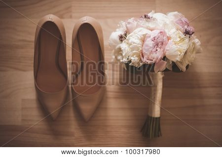Beautiful Bridal Bouquet With Wedding Shoe . Top View