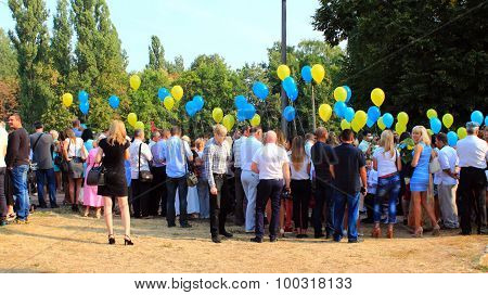 Children And Their Parents With Balloons On The Holiday