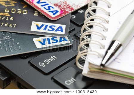 Nakhonratchasima, Thailand - August 1, 2015 : Credit Card Visa Brand With Pen On Keyboard.