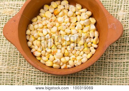 cut sweet white corn inside ceramic bowl