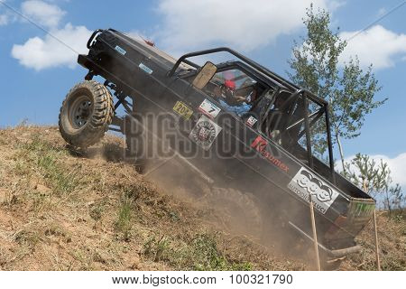 Black Off Road Car Is On The Top Of The Steep Hill