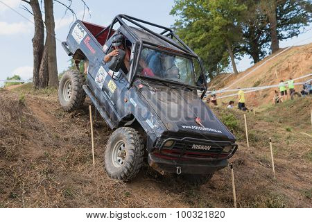 Off Road Car Is Sliding Down A Steep Slope