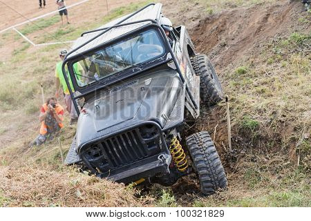Off Road Car Is Overcoming A  Difficult Terrain