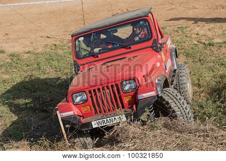 Red Off Road Car Is Exceeding The Difficult Terrain