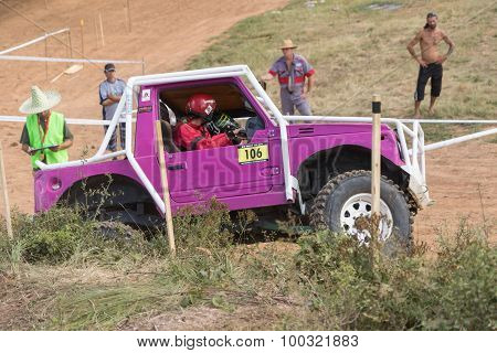 Side View Of The Purple Off Road Car In Terrain