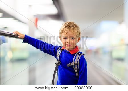 little boy travel in the airport or train station