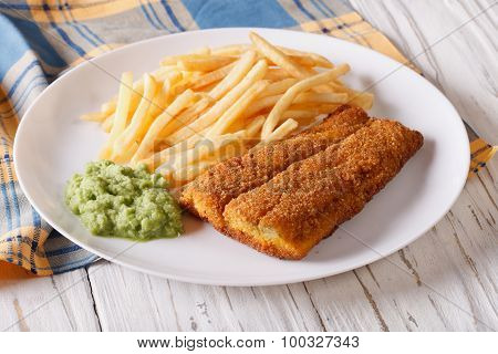 Fish In Breadcrumbs With Fried Potatoes. Horizontal
