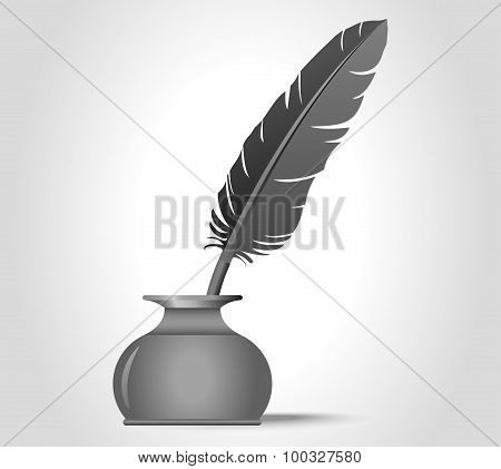 feather quill in the ink well