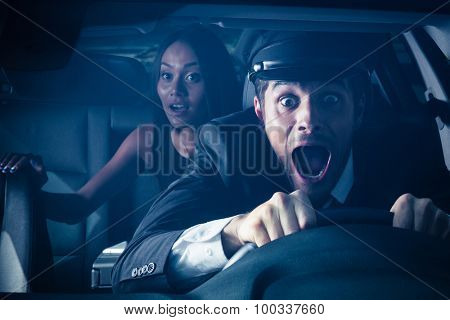 Male chauffeur with woman on back seat gets into car crash and makes ridiculous face