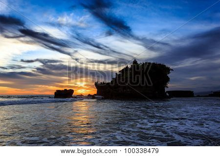 Tahah Lot Temple And Ocean Waves At Sunset, Bali