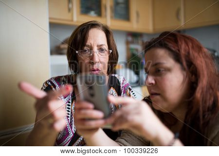 Mature Woman Learning To Use A Smartphone