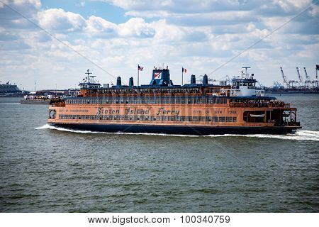 NEW YORK CITY, USA - SEPTEMBER, 2014: Staten island ferry leaving downtown Manhattan