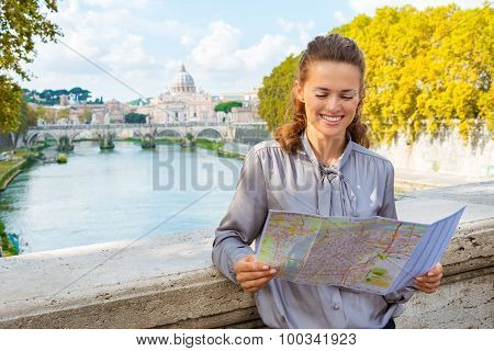 Elegant Woman Looking At Map Of Rome By Tiber River