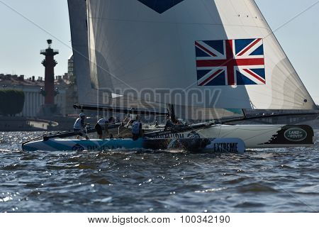 ST. PETERSBURG, RUSSIA - AUGUST 21, 2015: Catamaran of GAC Pindar sailing team of UK during the 2nd day of St. Petersburg stage of Extreme Sailing Series. Red Bull Sailing Team leading after 1st day