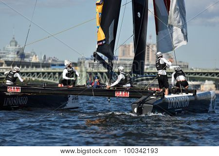 ST. PETERSBURG, RUSSIA - AUGUST 20, 2015: Catamaran of Lino Sonego Team Italia of Italy during the 1st day of St. Petersburg stage of Extreme Sailing Series. Red Bull Sailing Team won the day