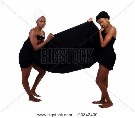 Two Black Sisters Standing Wrapped In Cloth