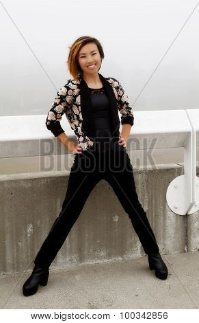 Smiling Skinny Asian American Woman Standing Outdoors