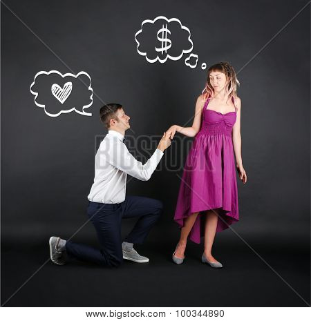 Romantic man proposing to a woman on black background