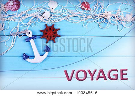 Voyage concept. Sea theme decor on blue wooden background