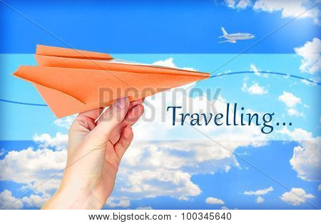 Travel concept. Origami paper airplane in hand on sky background