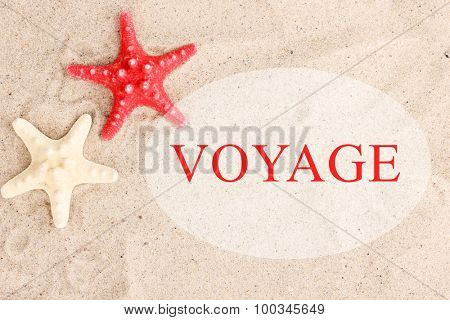 Voyage concept. Starfishes on sand