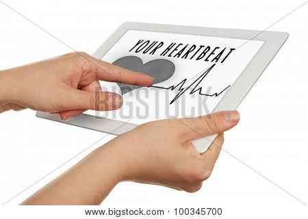 Hands holding tablet with health book app on the screen isolated on white