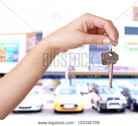 Keys in hand on blurred background store