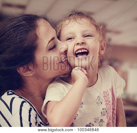 Beautiful Young Mother Kissing Her Joying Happy Cute Daughter