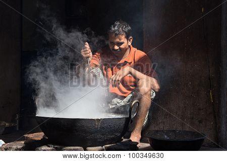 Indian Street Vendor Make Fast Food  In Old Wok The Fire . Pushkar, India