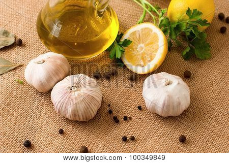 Slices Of Lemon, Garlic Cloves And Parsley On White Background