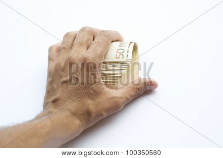 Concept or conceptual euro paper money banknote in human or man hands isolated on white background
