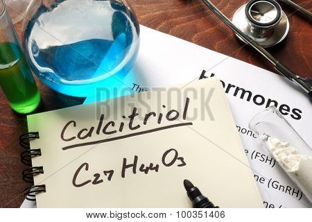 Hormone calcitriol written on notebook.