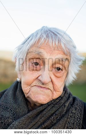 Elderly Woman With Resignation Expression