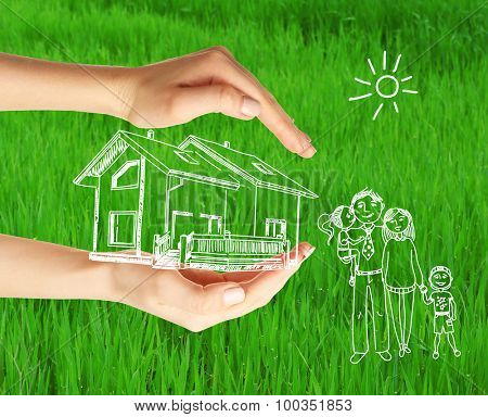 Vector image of happy family in hands, on green grass background