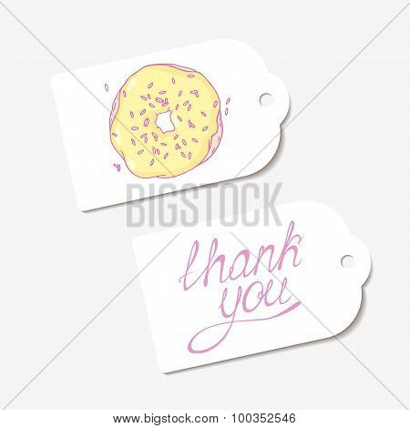 White paper tags. THANK YOU hand drawn lettering sign and sketched banana donut
